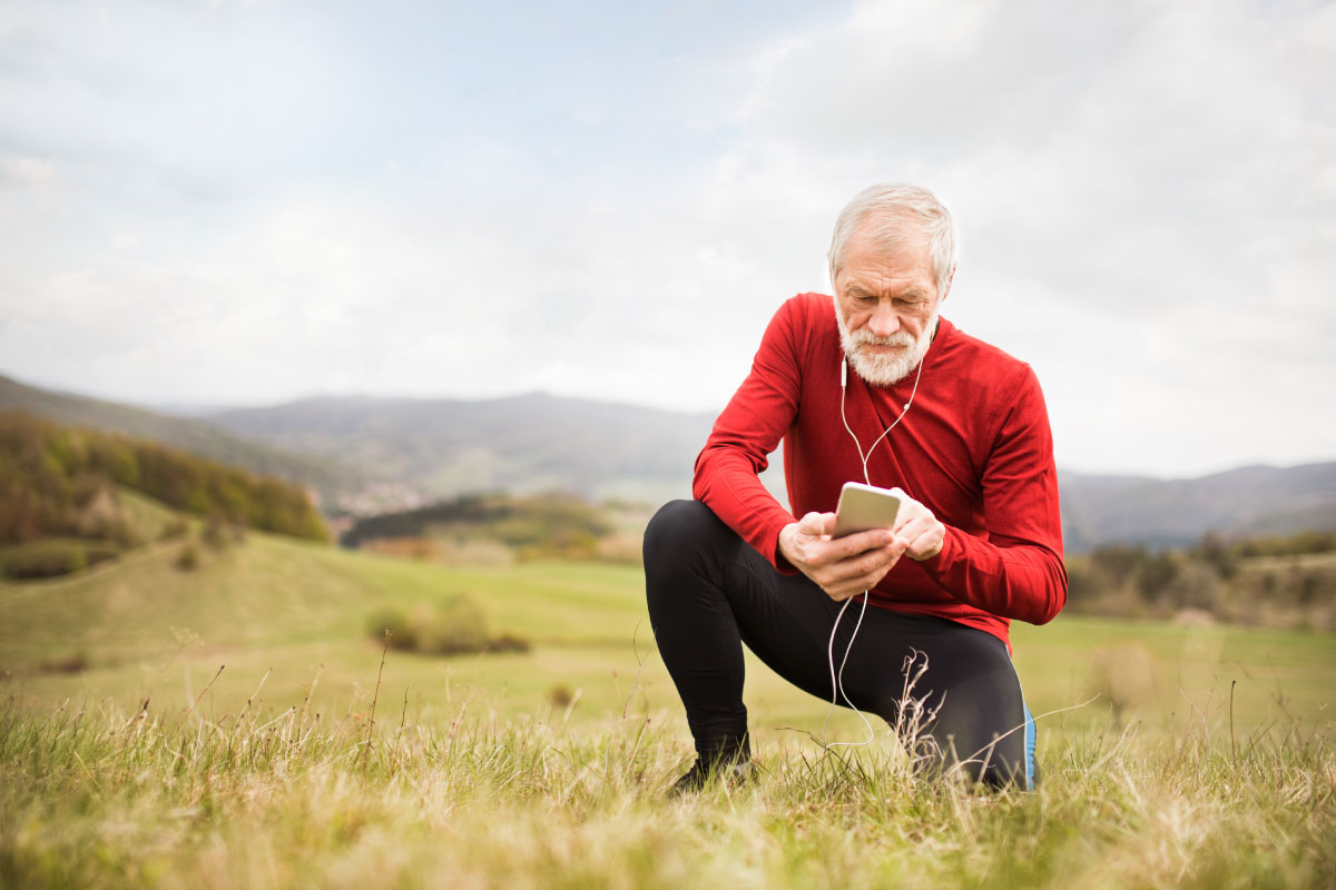 Man in Running gear on the phone